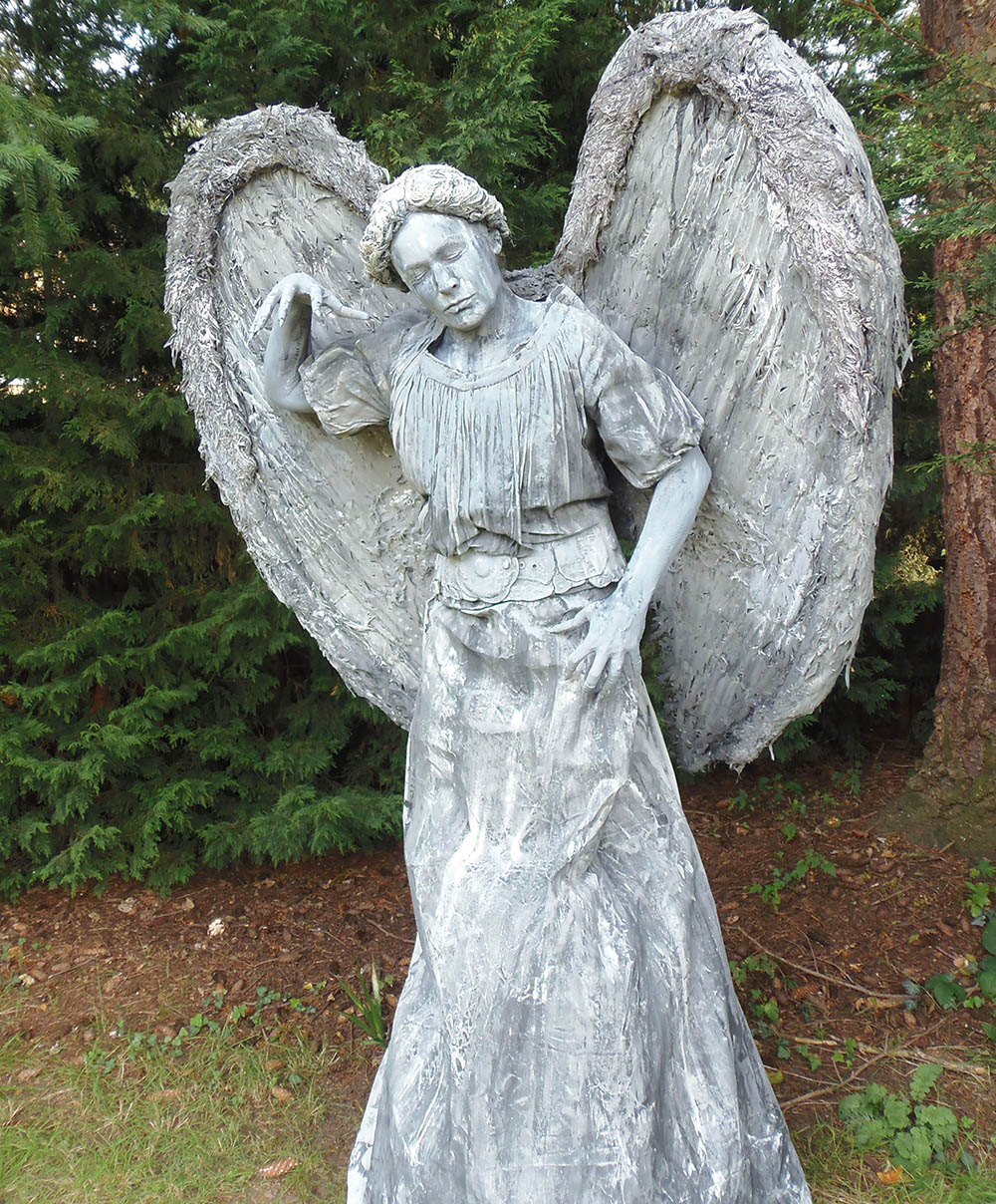 living angel statue