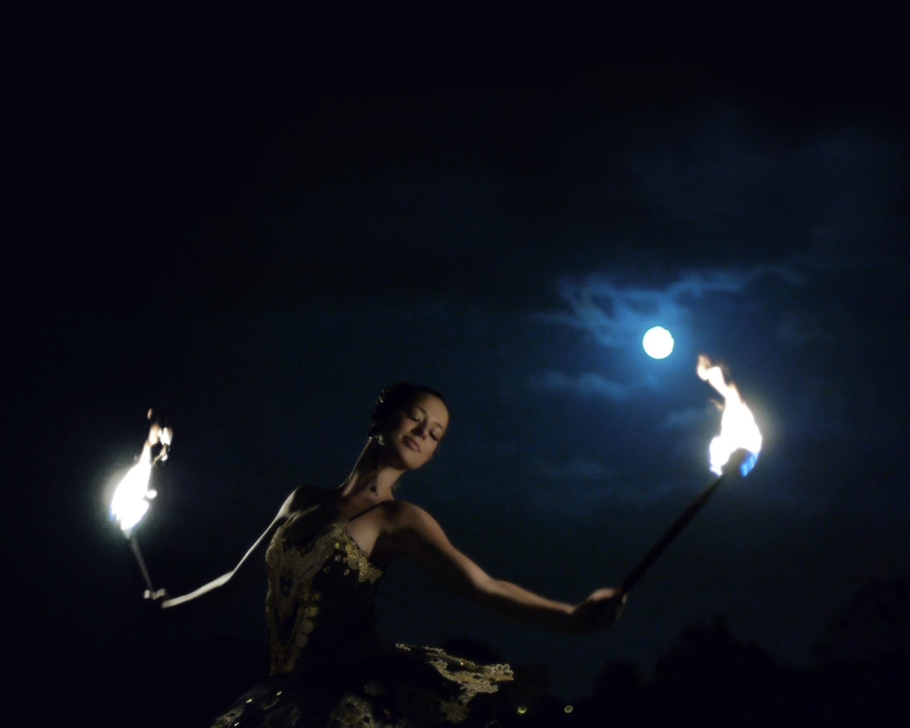 Fire ballet performance by moonlight