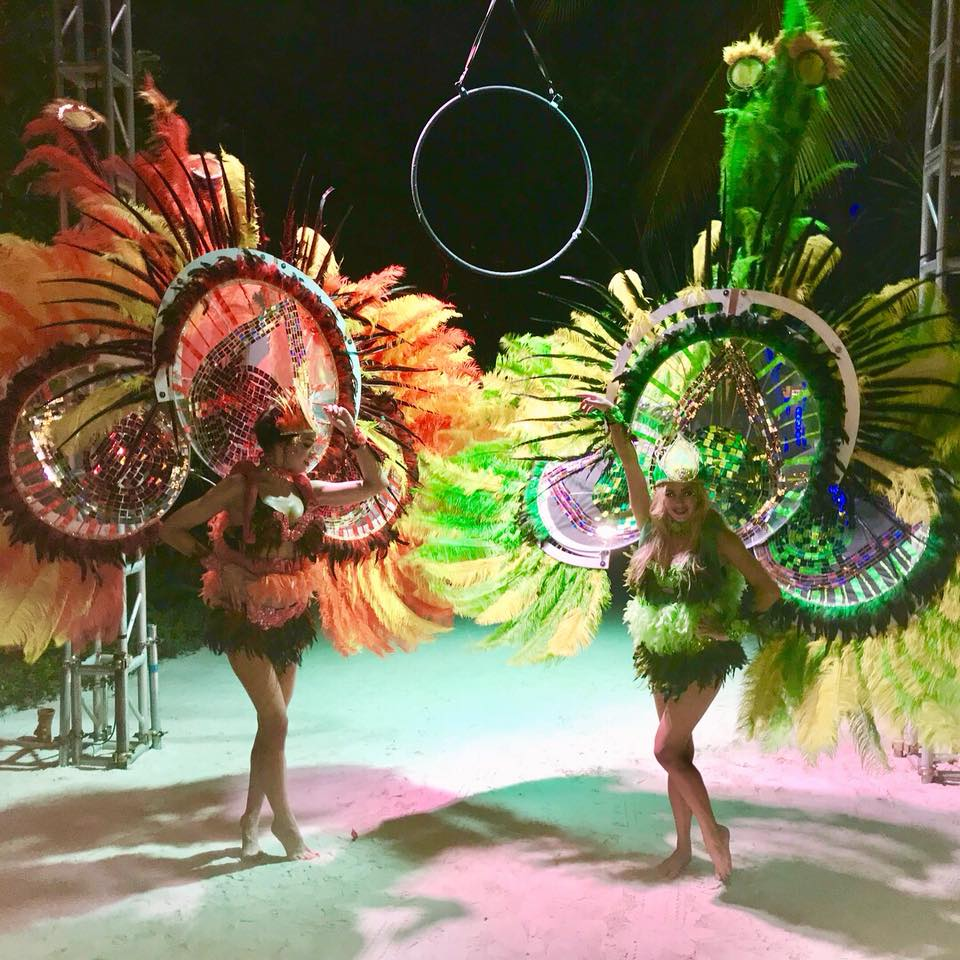 exotic carnival stilt walkabout rio beach feathers party